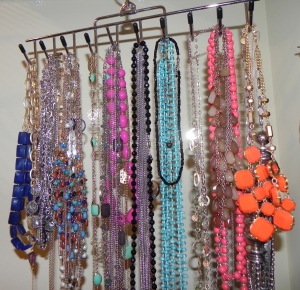 I hang my necklaces on a belt rack.