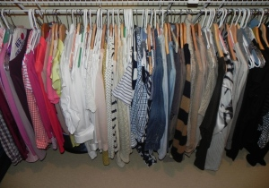 For my tops- I have them all hanging together and grouped by color. Looking at the picture- it's fun to see what color I tend to gravitate to- and what color I'm lacking (green?!)